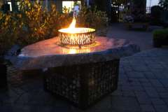 Custom Stone Fire Table with Decorative Flame Shield