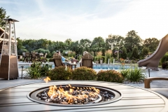 Round Firetable Near a Pool in Northeast WI