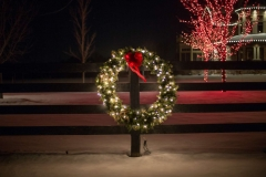 Lit evergreen holiday wreath and seasonal outdoor decor in Fox Cities, Wisconsin