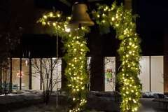 Lit evergreen garland for holiday displays