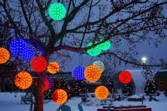 Colorful, hanging lit orbs for holiday displays