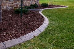 Concrete Curbing with Black Cherry Mulch Near Wrightstown, WI