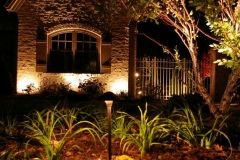 Outdoor Nightscaping Around a Planting Bed In Appleton