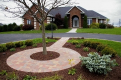 Circular Brick Walkway in a Planting Bed In Fox Cities Area