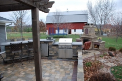 Outdoor Kitchen with Pergola and Fireplace