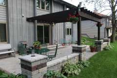 Stained Pergola Structure with Paver Pillar Base Near Oshkosh, WI