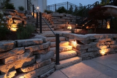 Natural Stone Wall with Lighting and Railing